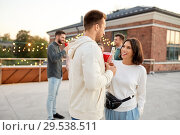 Купить «friends with non alcoholic drinks at rooftop party», фото № 29538511, снято 2 сентября 2018 г. (c) Syda Productions / Фотобанк Лори