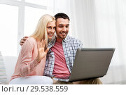 Купить «couple with laptop having video call at home», фото № 29538559, снято 6 июня 2015 г. (c) Syda Productions / Фотобанк Лори