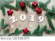 Купить «New Year 2019 background, 2019 figures, Christmas toys, green fir tree branches and snowflakes. New Year 2019 still life», фото № 29539071, снято 29 ноября 2016 г. (c) Зезелина Марина / Фотобанк Лори