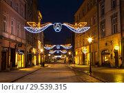 Купить «Night Krakow at Christmas, Grodskaya street. Poland», фото № 29539315, снято 31 декабря 2014 г. (c) Наталья Волкова / Фотобанк Лори