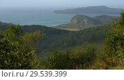 Купить «Beautiful autumn Pacific Coast seascape, mountain shore overgrown forest», видеоролик № 29539399, снято 24 сентября 2018 г. (c) А. А. Пирагис / Фотобанк Лори