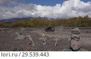 Купить «Japanese SUV rides on mount road on volcanic dry river in direction of volcano», видеоролик № 29539443, снято 27 сентября 2018 г. (c) А. А. Пирагис / Фотобанк Лори