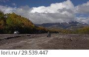 Купить «All-terrain vehicle driving on mount road on dry river in direction of volcano», видеоролик № 29539447, снято 27 сентября 2018 г. (c) А. А. Пирагис / Фотобанк Лори