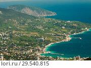 View of the Black Sea from Mount Ai-Petri. Below the village of Alupka Big Yalta. Sunny weather. Стоковое фото, фотограф Владимир Пойлов / Фотобанк Лори