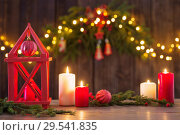 Купить «wooden lantern with candles and Christmas branchs on wooden background», фото № 29541835, снято 26 ноября 2018 г. (c) Майя Крученкова / Фотобанк Лори