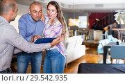 Купить «Couple shocked from looking through price-list», фото № 29542935, снято 16 мая 2017 г. (c) Яков Филимонов / Фотобанк Лори