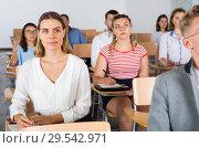 Купить «Girl during classes in auditorium», фото № 29542971, снято 25 июля 2018 г. (c) Яков Филимонов / Фотобанк Лори