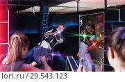 Купить «Girls and guys playing laser tag game opposite each other in da», фото № 29543123, снято 27 августа 2018 г. (c) Яков Филимонов / Фотобанк Лори