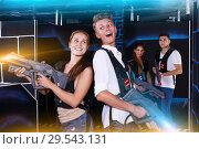 Купить «Guy and girl are happy with their victory in laser tag game», фото № 29543131, снято 27 августа 2018 г. (c) Яков Филимонов / Фотобанк Лори