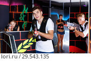 Купить «Portrait of excited guy with laser pistol playing laser tag in a», фото № 29543135, снято 27 августа 2018 г. (c) Яков Филимонов / Фотобанк Лори