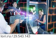 Купить «Laser tag players guys and girls playing in teams in dark laser», фото № 29543143, снято 27 августа 2018 г. (c) Яков Филимонов / Фотобанк Лори