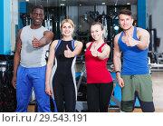 Купить «Athletic people posing in gym», фото № 29543191, снято 16 апреля 2018 г. (c) Яков Филимонов / Фотобанк Лори