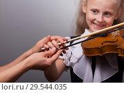 Купить «Learning to play the violin. Smiling girl at lesson», фото № 29544035, снято 10 октября 2018 г. (c) Сергей Молодиков / Фотобанк Лори