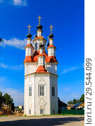 Купить «Russian white orthodox Temple of the Entry of the Lord into Jerusalem against the blue sky The Nativity Church, Totma, Russia. Architectural forms reminiscent of a ship», фото № 29544099, снято 17 июня 2019 г. (c) Mikhail Starodubov / Фотобанк Лори