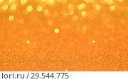 Купить «Yellow Christmas or New Year background», видеоролик № 29544775, снято 9 декабря 2018 г. (c) Сергей Петерман / Фотобанк Лори