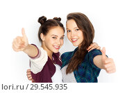 Купить «happy teenage girls hugging and showing thumbs up», фото № 29545935, снято 19 декабря 2015 г. (c) Syda Productions / Фотобанк Лори