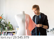 Купить «fashion designer with dummy making dress at studio», фото № 29545979, снято 28 июня 2017 г. (c) Syda Productions / Фотобанк Лори