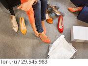 Купить «young woman trying high heeled shoes at store», фото № 29545983, снято 22 сентября 2017 г. (c) Syda Productions / Фотобанк Лори