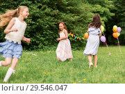 Купить «happy girls playing tag game at birthday party», фото № 29546047, снято 27 мая 2018 г. (c) Syda Productions / Фотобанк Лори