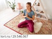 Купить «woman meditating in lotus pose at yoga studio», фото № 29546067, снято 21 июня 2018 г. (c) Syda Productions / Фотобанк Лори