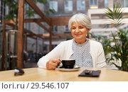 Купить «senior woman drinking coffee at street cafe», фото № 29546107, снято 3 августа 2018 г. (c) Syda Productions / Фотобанк Лори