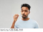 Купить «man measuring oral temperature by thermometer», фото № 29546191, снято 27 октября 2018 г. (c) Syda Productions / Фотобанк Лори