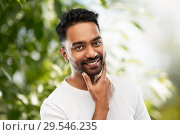Купить «smiling indian man touching his beard», фото № 29546235, снято 27 октября 2018 г. (c) Syda Productions / Фотобанк Лори