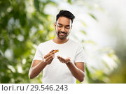 Купить «indian man applying grooming oil to his hand», фото № 29546243, снято 27 октября 2018 г. (c) Syda Productions / Фотобанк Лори