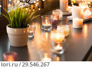 Купить «candles burning on window sill with garland lights», фото № 29546267, снято 13 января 2018 г. (c) Syda Productions / Фотобанк Лори