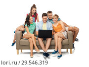 Купить «friends with laptop computer sitting on sofa», фото № 29546319, снято 30 июня 2018 г. (c) Syda Productions / Фотобанк Лори