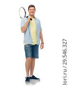 Купить «smiling young man with tennis racket», фото № 29546327, снято 30 июня 2018 г. (c) Syda Productions / Фотобанк Лори