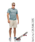 Купить «smiling young man with skateboard over white», фото № 29546335, снято 30 июня 2018 г. (c) Syda Productions / Фотобанк Лори