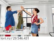 Купить «happy creative team making high five at office», фото № 29546431, снято 1 апреля 2018 г. (c) Syda Productions / Фотобанк Лори