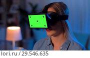 Купить «happy young woman in vr glasses at home at night», видеоролик № 29546635, снято 23 мая 2019 г. (c) Syda Productions / Фотобанк Лори