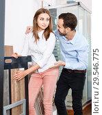 Купить «Happy spouses shopping for modern ceramic tiles in shop of kitchen materials and furniture», фото № 29546775, снято 11 апреля 2018 г. (c) Яков Филимонов / Фотобанк Лори