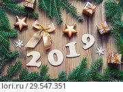 Купить «New Year 2019 festive background with 2019 figures, Christmas toys,green fir tree branches and snowflakes - 2019 design», фото № 29547351, снято 29 ноября 2016 г. (c) Зезелина Марина / Фотобанк Лори