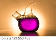 Retort with blue chemical reagent. Chemical experiment with Laboratory glass. Стоковое фото, фотограф Евгений Ткачёв / Фотобанк Лори