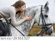 woman with a horse for a walk. Стоковое фото, фотограф Типляшина Евгения / Фотобанк Лори