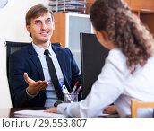 Купить «Friendly hr manager inreviewing competitor», фото № 29553807, снято 23 мая 2019 г. (c) Яков Филимонов / Фотобанк Лори