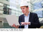 Купить «Cheerful male talking about work at the laptop», фото № 29553927, снято 20 апреля 2017 г. (c) Яков Филимонов / Фотобанк Лори