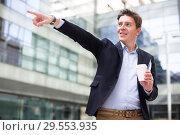 Купить «Male pointing finger at object», фото № 29553935, снято 20 апреля 2017 г. (c) Яков Филимонов / Фотобанк Лори