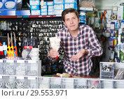 Купить «Male selling brushes for repair», фото № 29553971, снято 4 мая 2017 г. (c) Яков Филимонов / Фотобанк Лори