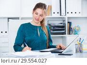 Купить «Young business woman at workplace», фото № 29554027, снято 31 июля 2017 г. (c) Яков Филимонов / Фотобанк Лори