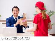Купить «Courier delivering parcel to the office», фото № 29554723, снято 5 июля 2018 г. (c) Elnur / Фотобанк Лори