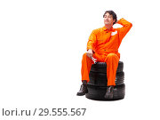 Купить «Young garage worker with tyre isolated on white», фото № 29555567, снято 21 июля 2018 г. (c) Elnur / Фотобанк Лори