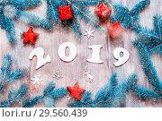 Купить «New Year 2019 background -2019 figures, Christmas toys, blue fir tree branches and snowflakes. New Year 2019 holiday», фото № 29560439, снято 29 ноября 2016 г. (c) Зезелина Марина / Фотобанк Лори