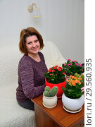 Купить «A housewife caring for plants in pots», фото № 29560935, снято 20 ноября 2017 г. (c) Володина Ольга / Фотобанк Лори