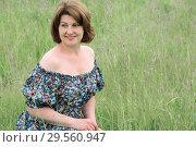 Купить «Portrait of beautiful woman in the grass on a summer day», фото № 29560947, снято 19 июня 2017 г. (c) Володина Ольга / Фотобанк Лори