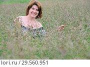 Купить «Portrait of woman in the grass on a summer day», фото № 29560951, снято 19 июня 2017 г. (c) Володина Ольга / Фотобанк Лори