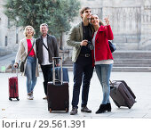 Купить «Family of four with trunks walking through city street», фото № 29561391, снято 19 января 2019 г. (c) Яков Филимонов / Фотобанк Лори